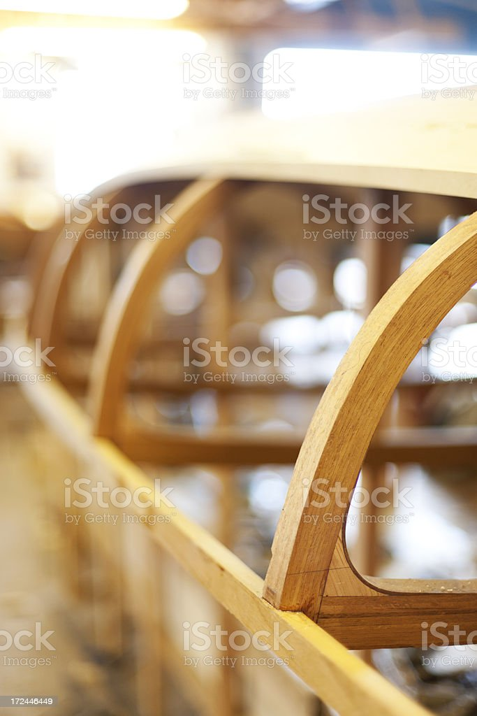 Unfinished wooden boat stock photo