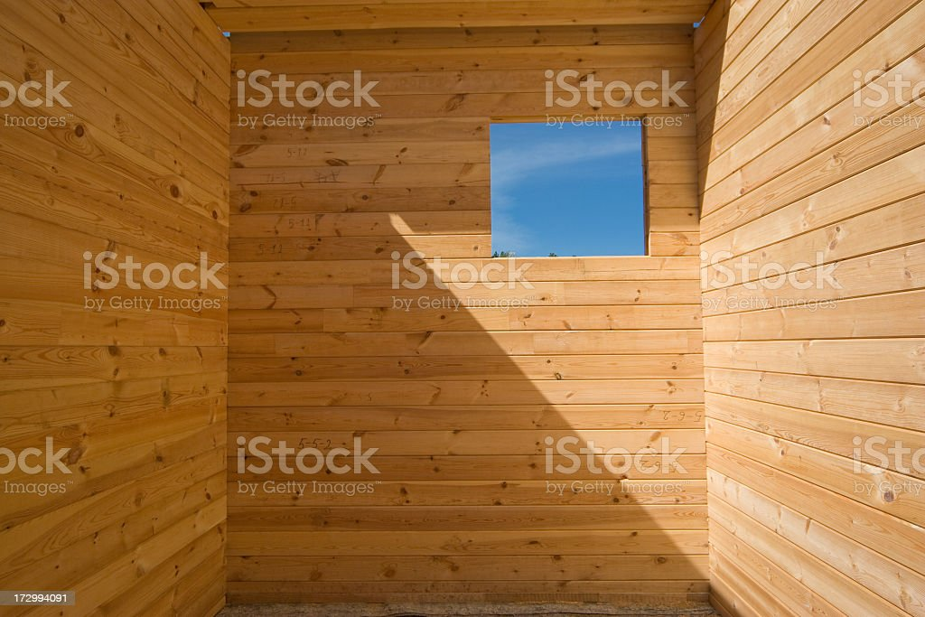 Unfinished wooden house stock photo