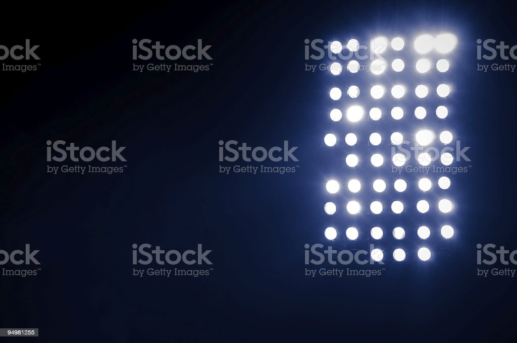 Unfocused stadium lights on black background stock photo