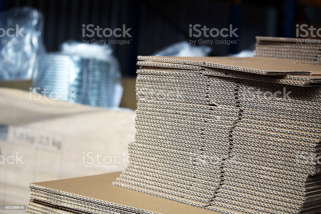 Unfolded cardboards for boxes in the warehouse stock photo