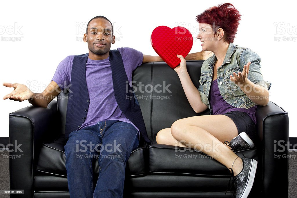 Ungrateful girl on Valentines Day upset about gift stock photo