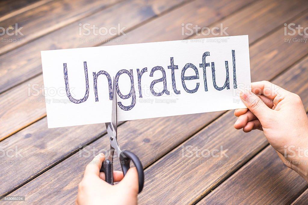 ungrateful to grateful by scissors stock photo