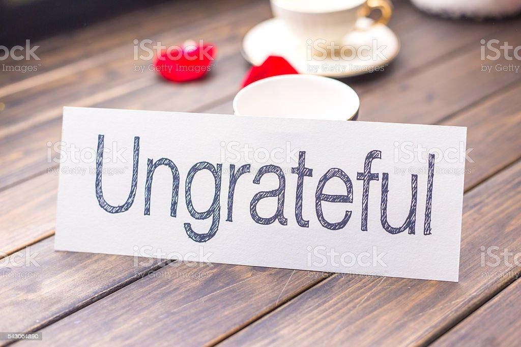 ungrateful to grateful on white paper stock photo