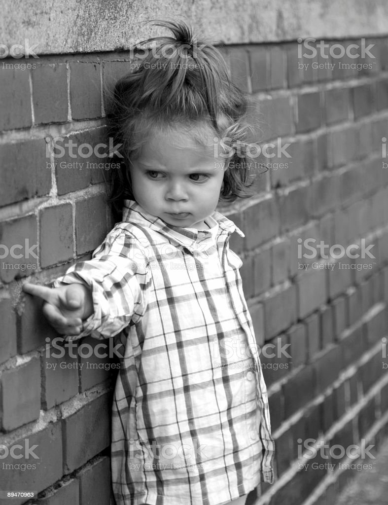 Ungry baby girl at wall royalty-free stock photo