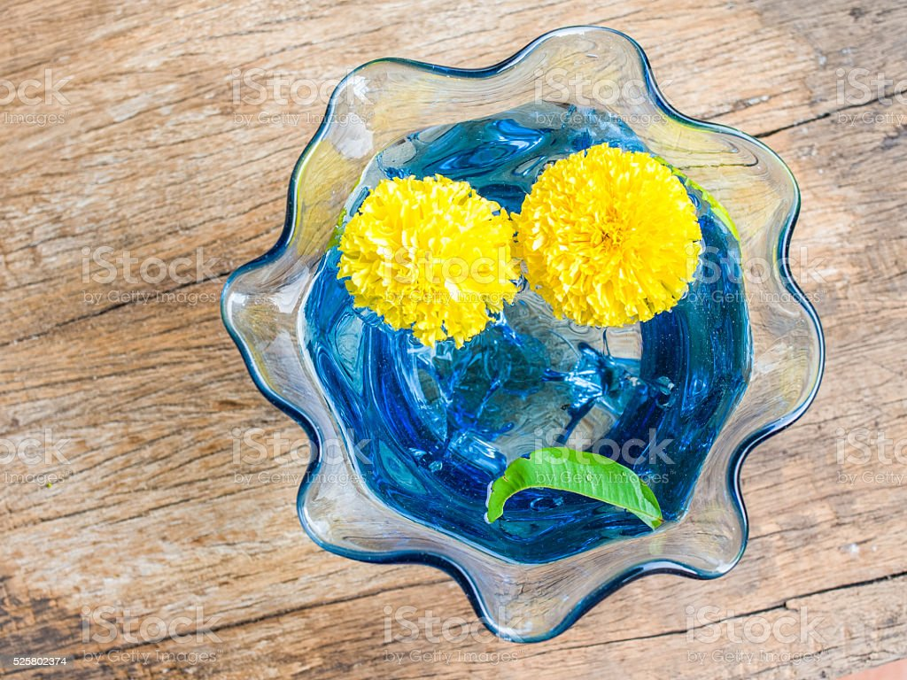 Unhappiness Face With Marigold Flower Stock Photo More Pictures Of