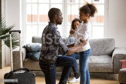 istock Unhappy African American father saying goodbye to daughter 1085009310