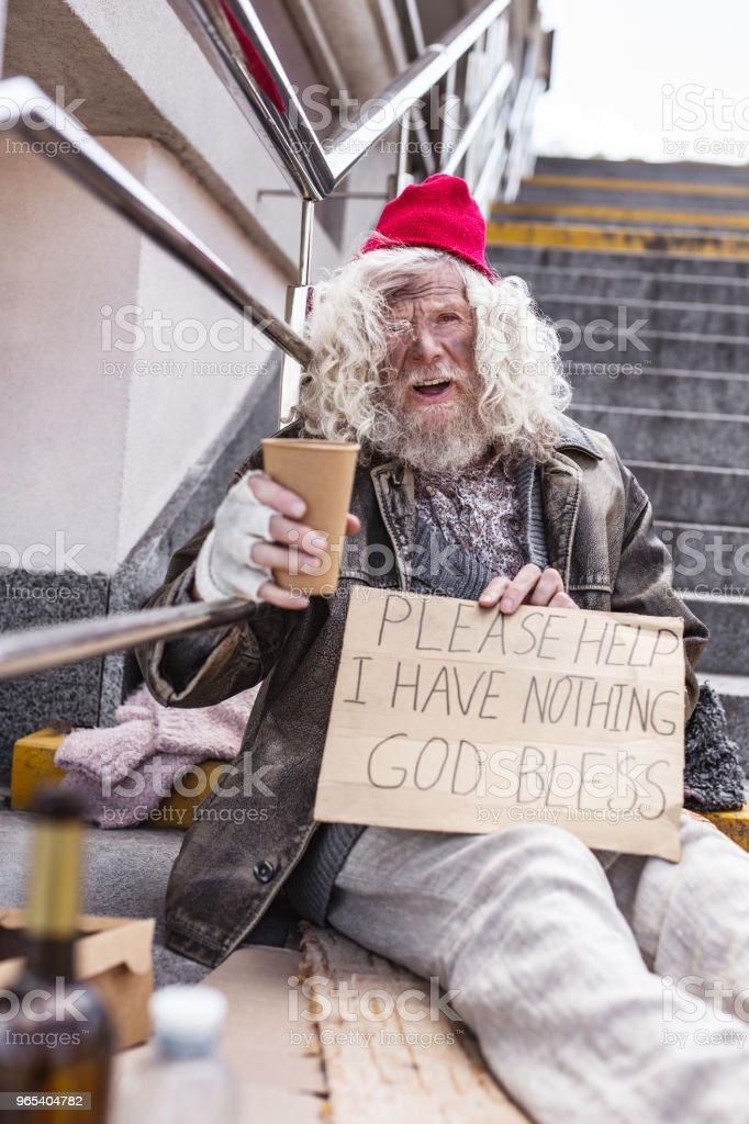 Unhappy aged man asking for help zbiór zdjęć royalty-free