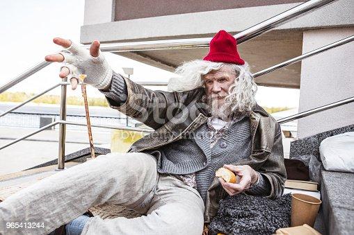 Unhappy Aged Man Stretching Out His Hand - Stockowe zdjęcia i więcej obrazów Baby boomer
