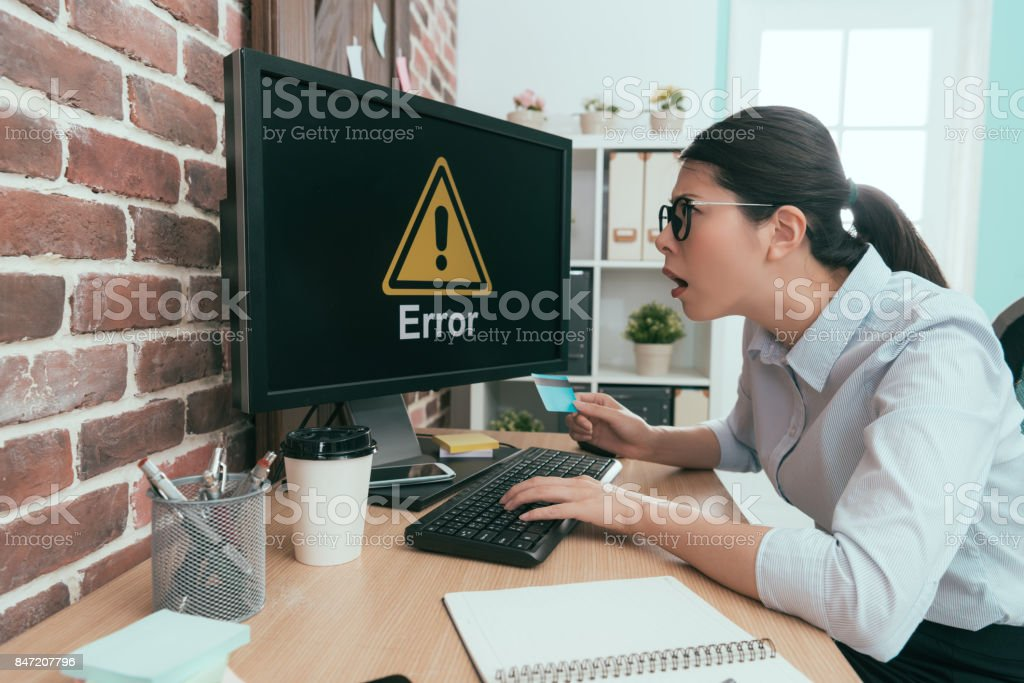 Unhappy Agent Lady Using Personal Credit Card stock photo | iStock