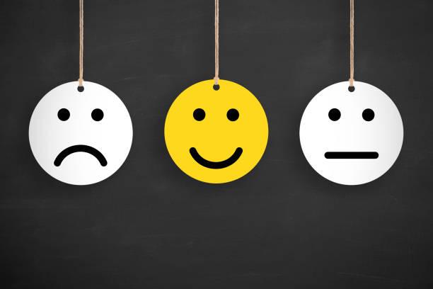 unhappy and happy on blackboard - perito foto e immagini stock