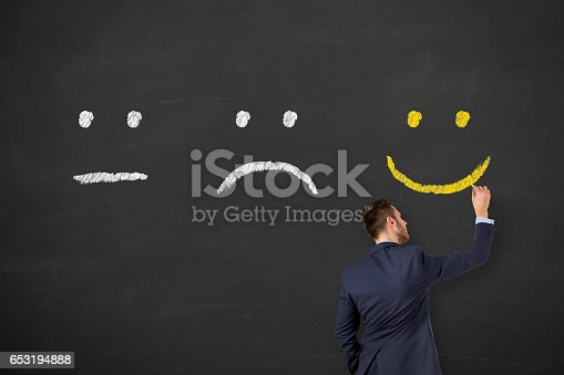 istock Unhappy and Happy on Chalkboard 653194888