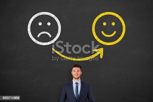 istock Unhappy and Happy over Human Head on Blackboard 935214968