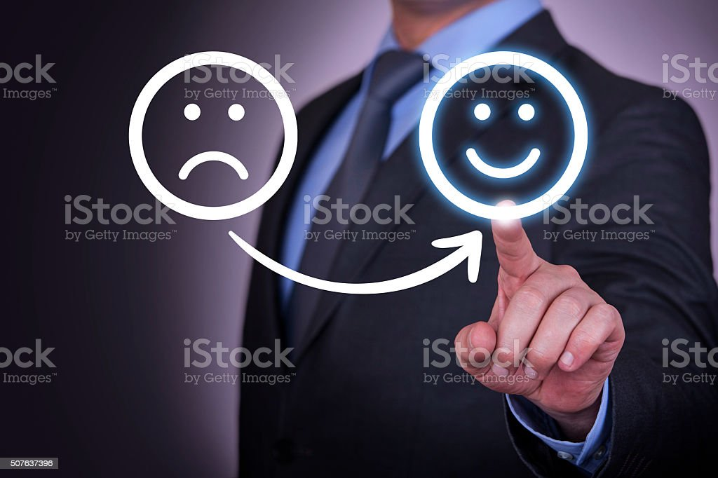 Unhappy and Happy Smileys on Touch Screen stock photo