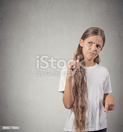 istock unhappy angry teenager girl giving signs with arms 666079662
