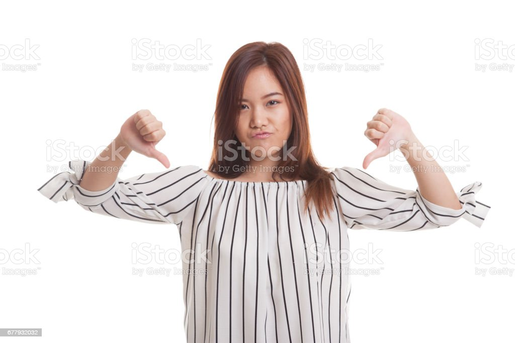 Unhappy Asian girl show thumbs down with both hands. royalty-free stock photo