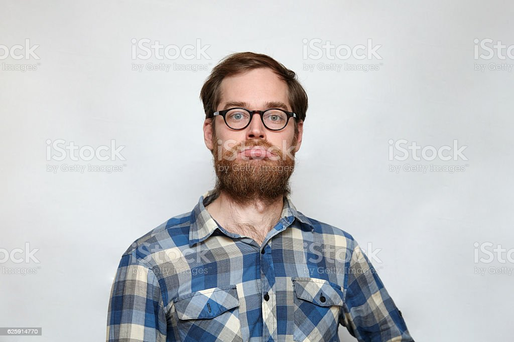 Unhappy bearded man in eyeglasses pouting his lips – Foto