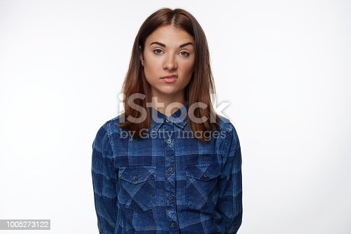 istock Unhappy beautiful brunette young female frowns face in displeasure 1005273122