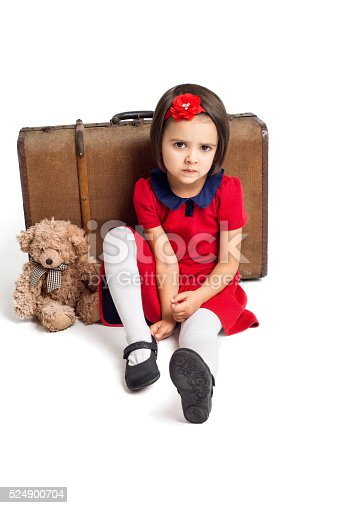 953553492 istock photo Unhappy beautiful little Girl with suitcase and toy bear 524900704