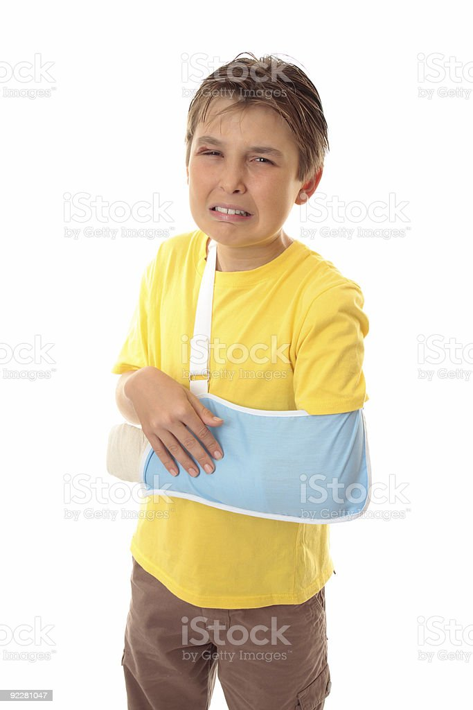 Unhappy boy broken arm royalty-free stock photo