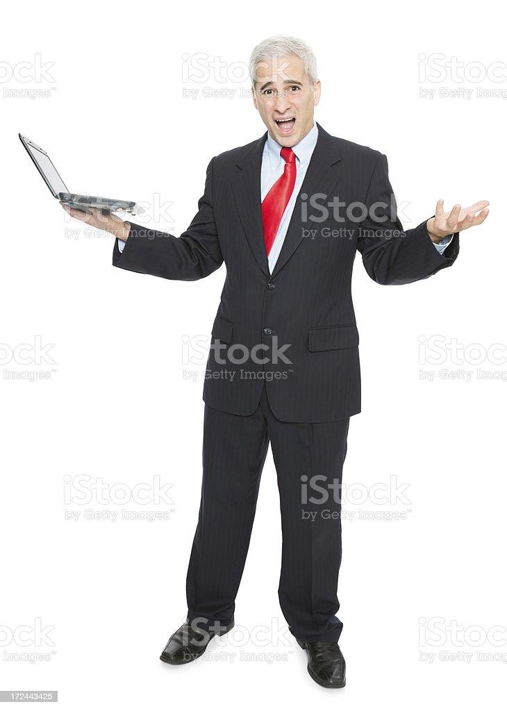 Unhappy Businessman Holding Laptop royalty-free stock photo