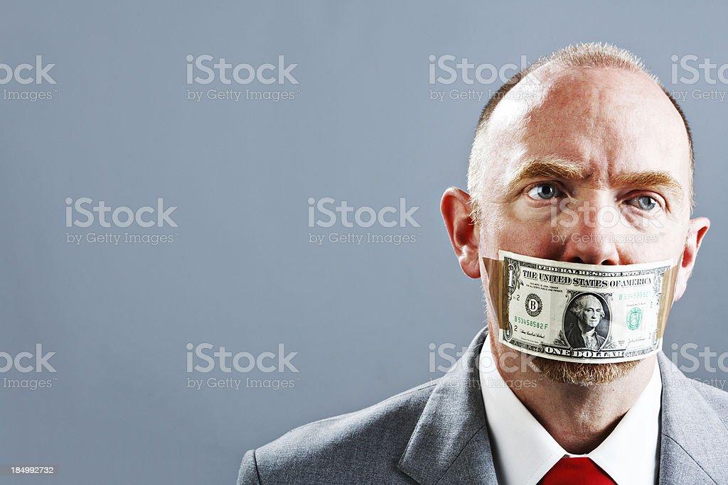 Unhappy businessman in US dollar gag stock photo