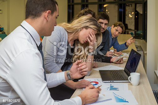 istock Unhappy businesswoman on a corporate meeting 871801570