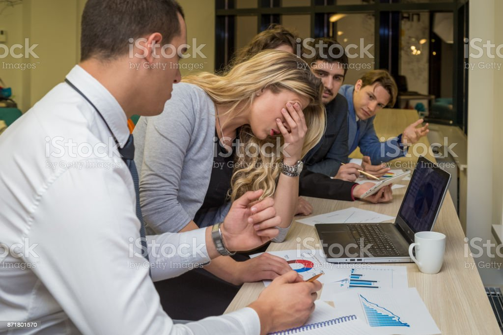 Unhappy businesswoman on a corporate meeting stock photo