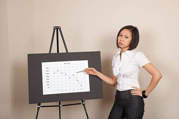 Unhappy businesswoman with chart stock photo