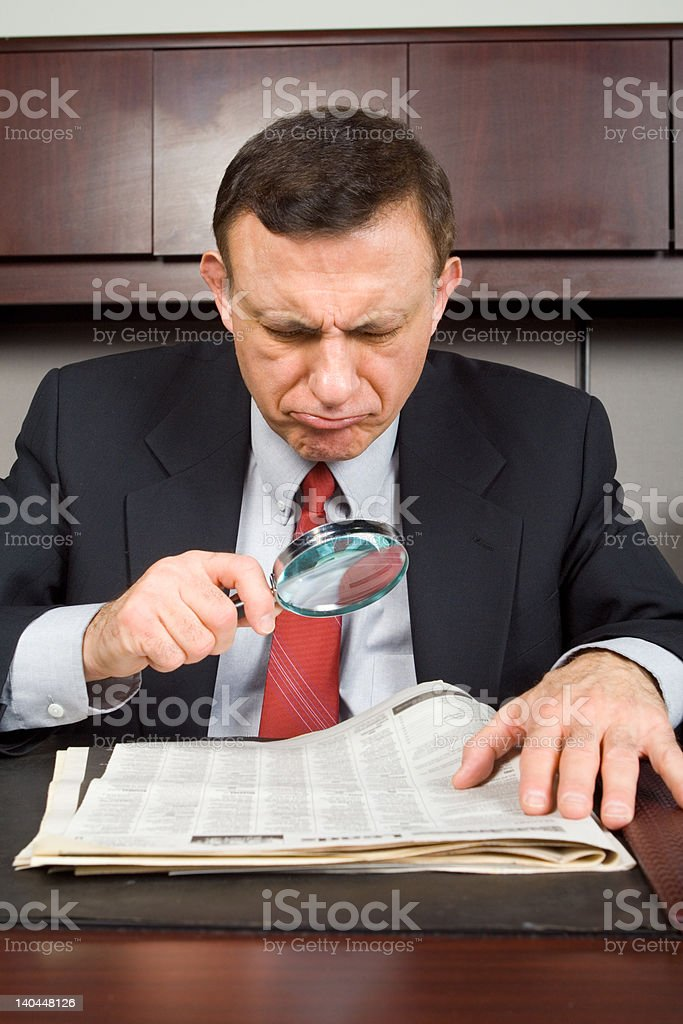 Unhappy Caucasian Man Reading Paper Magnifying Glass royalty-free stock photo