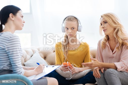 istock Unhappy cheerless woman trying to help her daughter 863624276