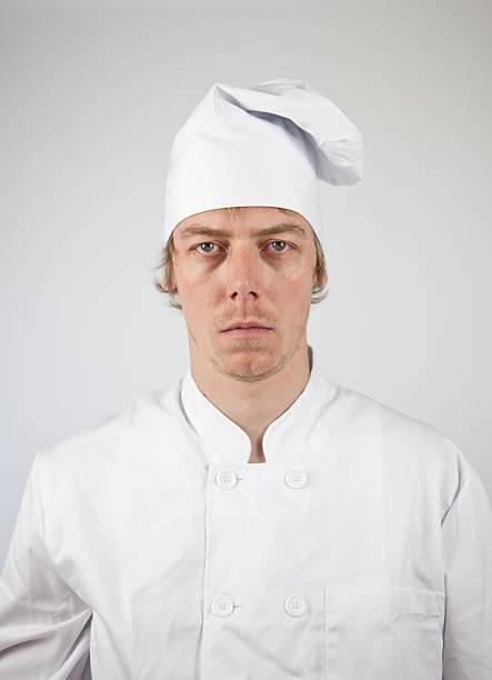 infelice chef stares alla macchina fotografica - chef triste foto e immagini stock