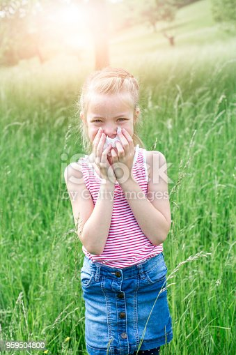 629307146istockphoto unhappy child with grasses allergy in the meadow in austria 959504800