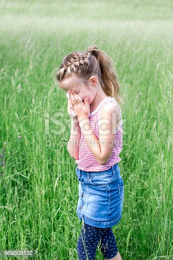 629307146istockphoto unhappy child with grasses allergy in the meadow in austria 959505132