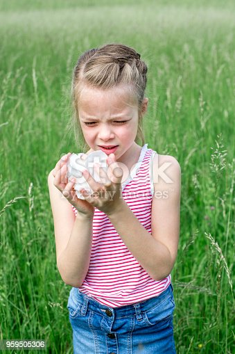 629307146istockphoto unhappy child with grasses allergy in the meadow in austria 959505306