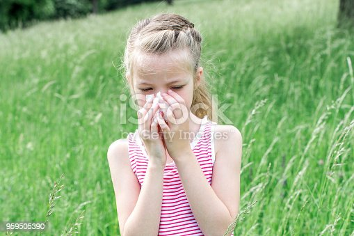 629307146istockphoto unhappy child with grasses allergy in the meadow in austria 959505390