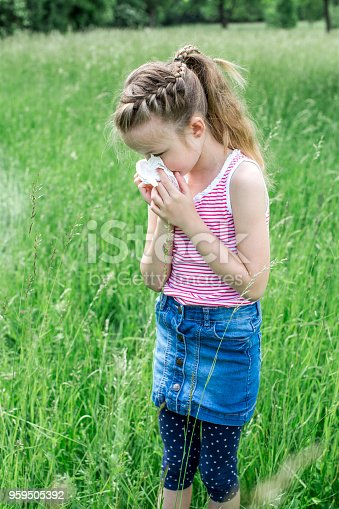 629307146istockphoto unhappy child with grasses allergy in the meadow in austria 959505392