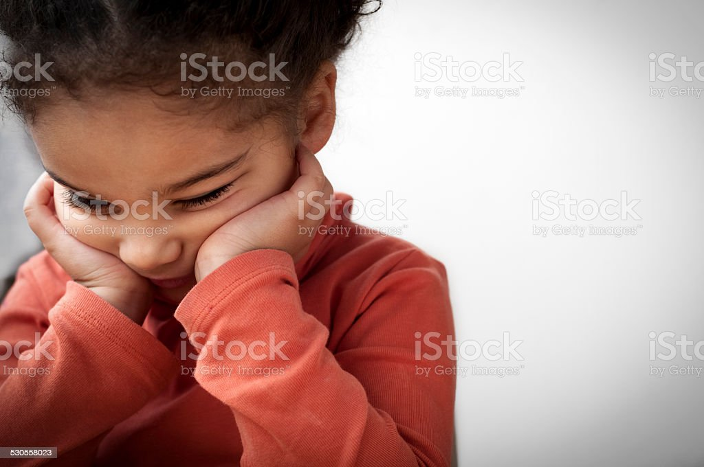 Unhappy Child (4-5)  With Her Head in Hands stock photo