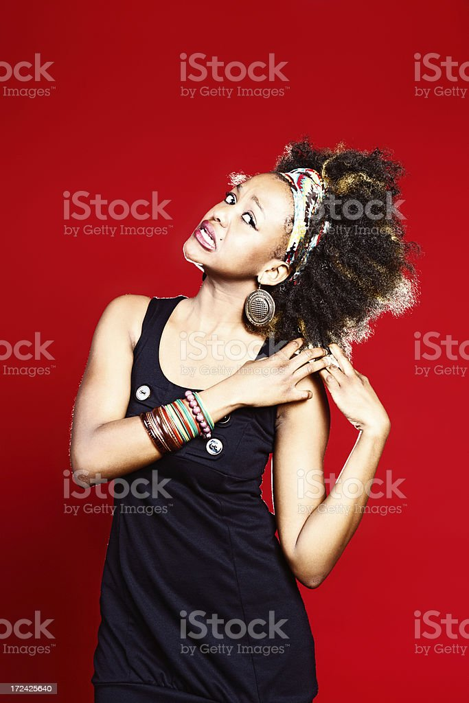 Unhappy, confused woman grimaces and tugs her hair royalty-free stock photo