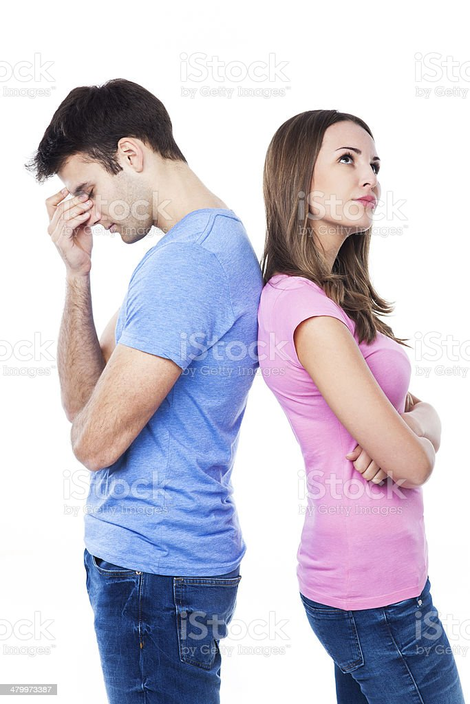Unhappy couple standing back to back stock photo
