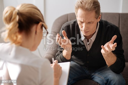 istock Unhappy depressed man speaking about his problems 656137434