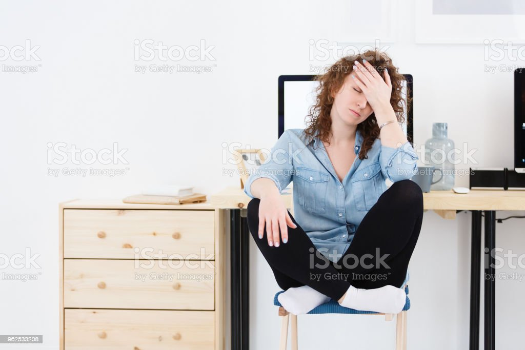 Unhappy disappointed woman with stubble covers face with hand has much work and sleppless night. Stress, fatigue overwork. - Royalty-free Adult Stock Photo