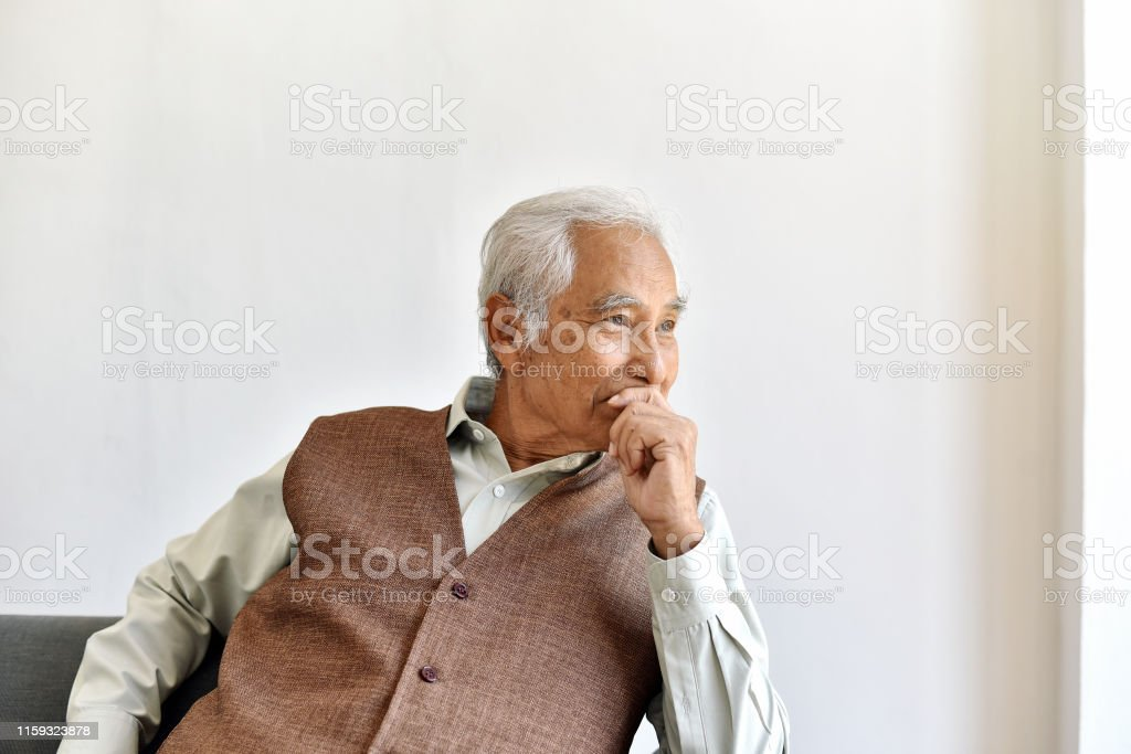 Unhappy elderly asian man with carefully thought gesture, Lonely old...