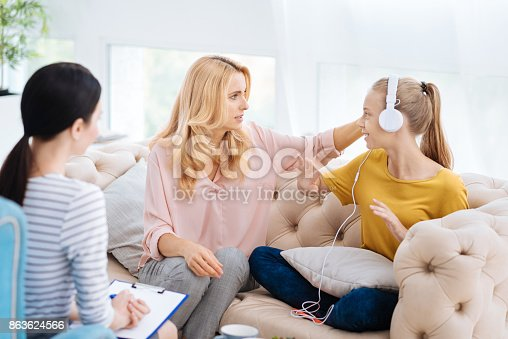 istock Unhappy emotional girl looking at her mother 863624566