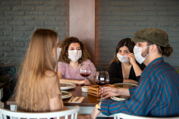 unhappy friends protected from coronavirus - coronavirus stock pictures, royalty-free photos & images