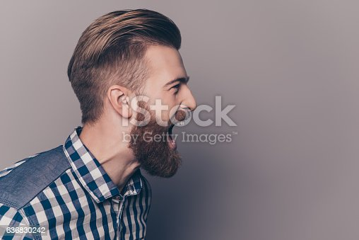 istock unhappy furious businessman open mouth and shouting 636830242