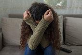 istock Unhappy girl on sofa 1136756030