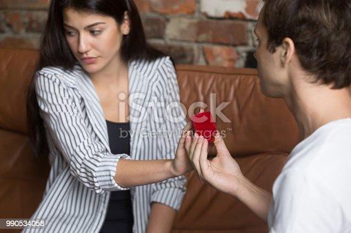 1129577106 istock photo Unhappy girl refusing to marriage proposal of boyfriend 990534058
