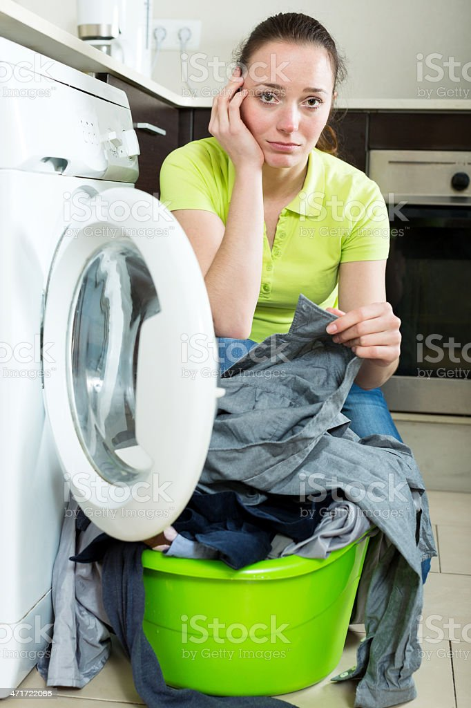Unhappy girl with dirty clothes stock photo