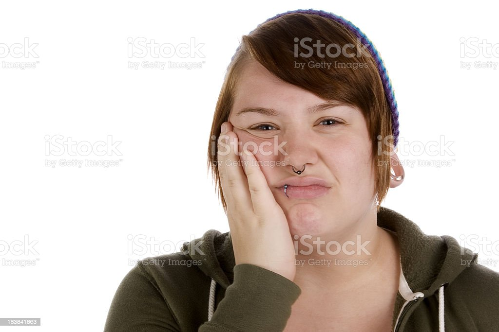 Unhappy grunge teen with hand on face stock photo