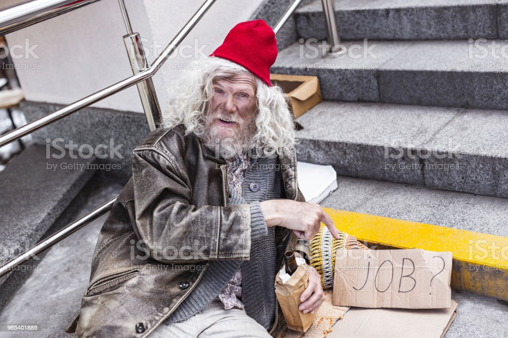 Unhappy jobless man pointing at the sign royalty-free stock photo